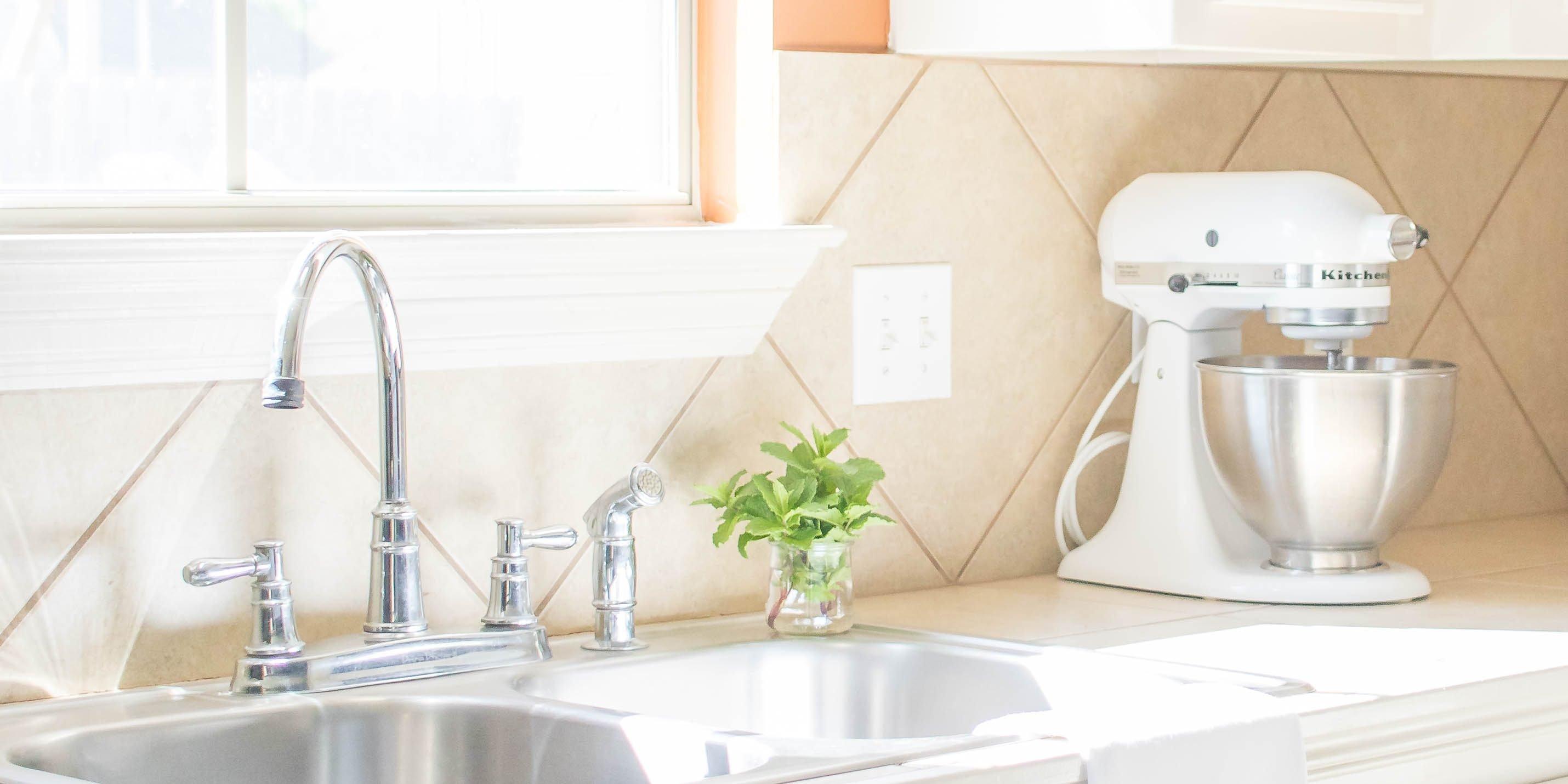 white kitchenaid stand mixer in bright kitchen