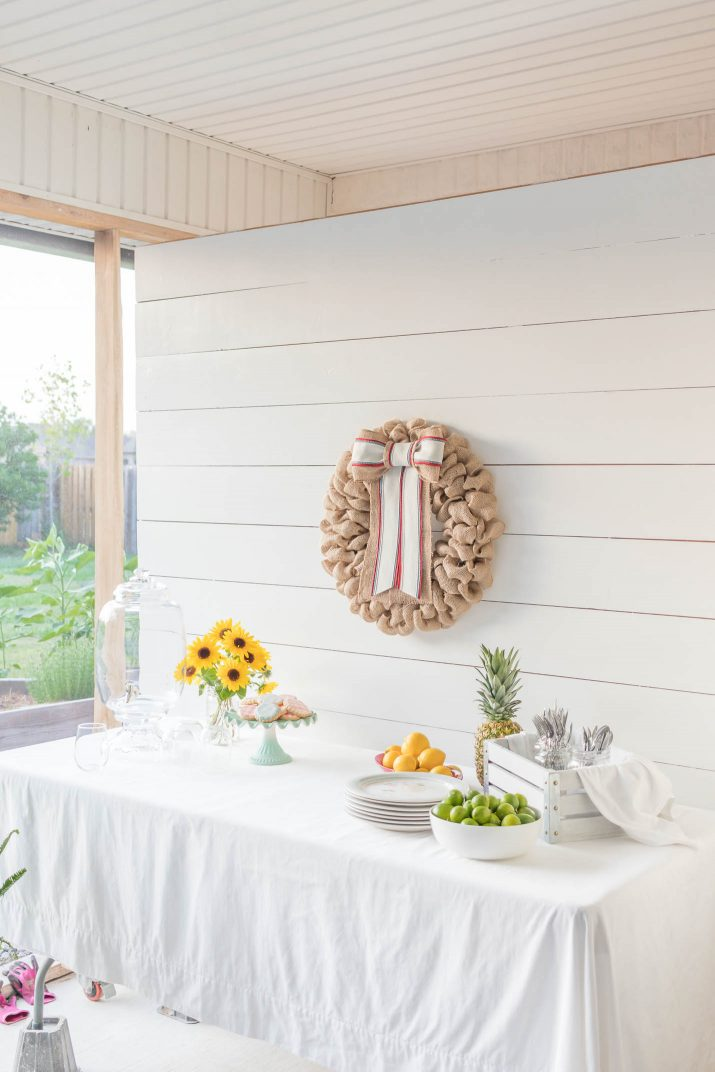 shiplap wall with burlap wreath for summer photography shoot